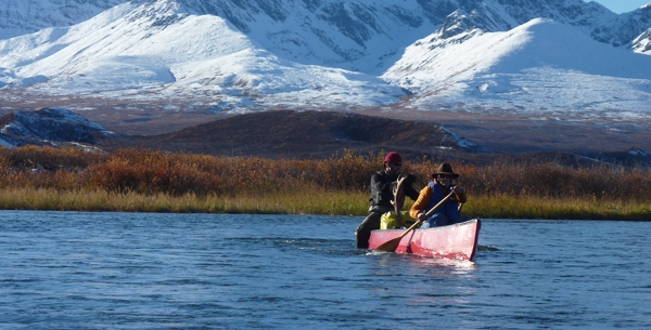 My canoe partner, Jason, and I making our way down stream with a canoe full of Jason's caribou.